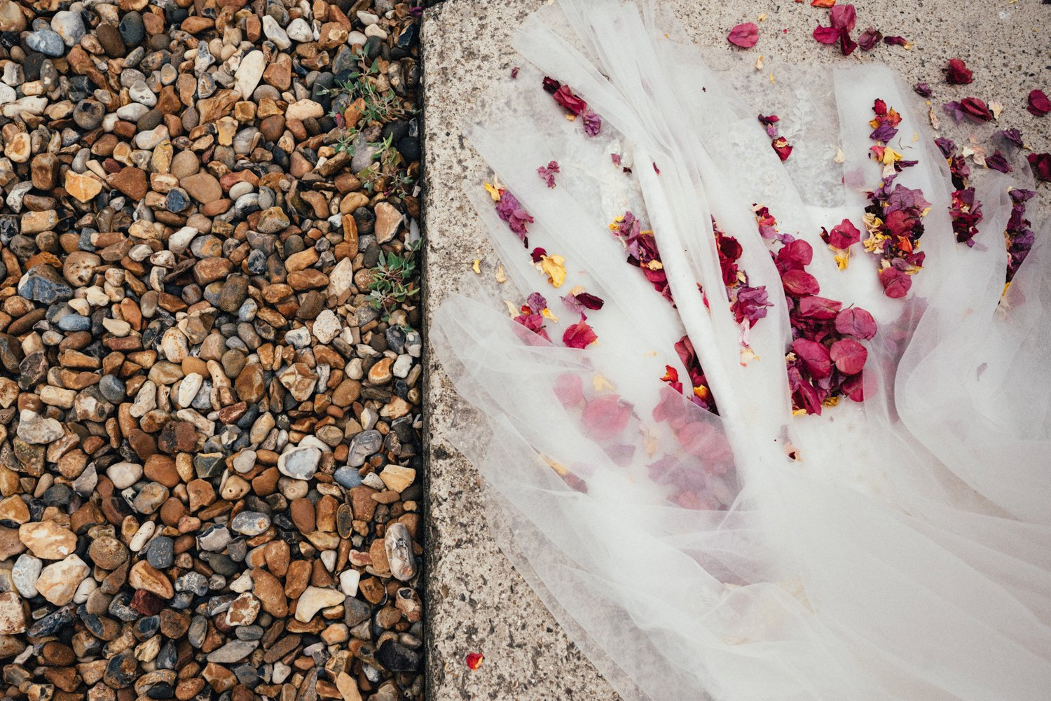 Seaside wedding pebbles and confetti