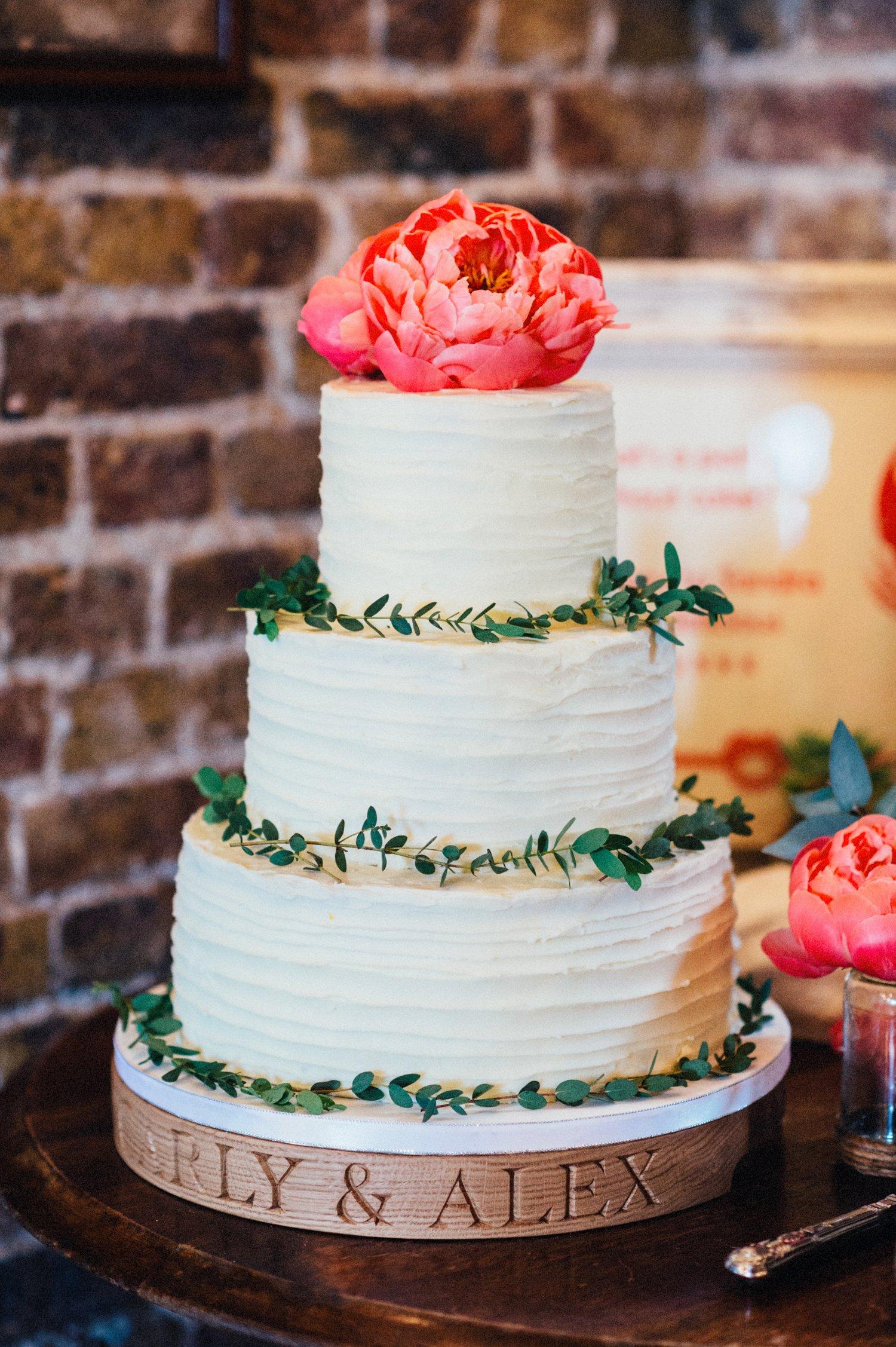 Three tiered wedding cake with rose BABB