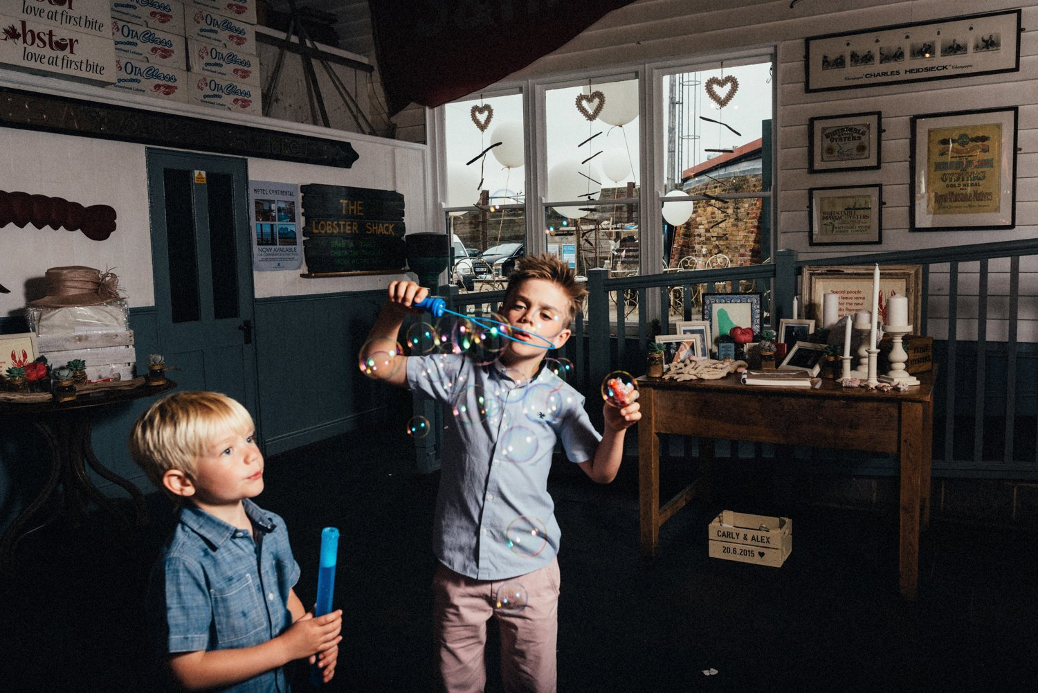 Boys blow bubbles Whitstable wedding