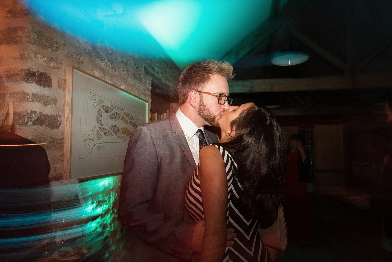 Wedding guests kiss Hauser & Wirth wedding Somerset