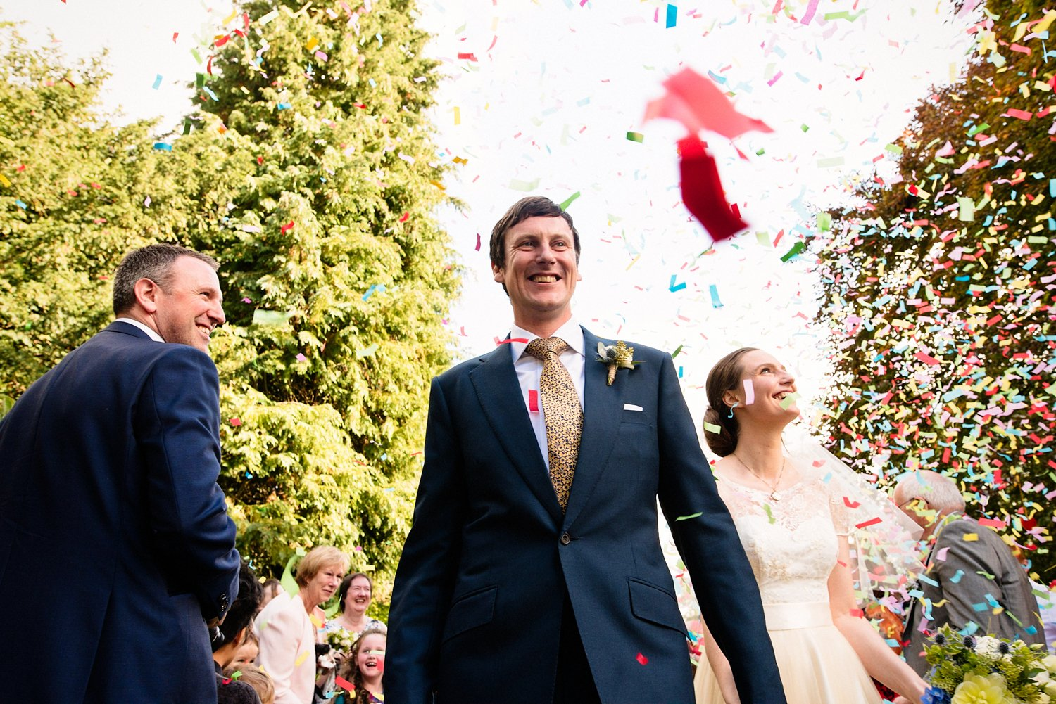 Cad and the Dandy groom covered in confetti