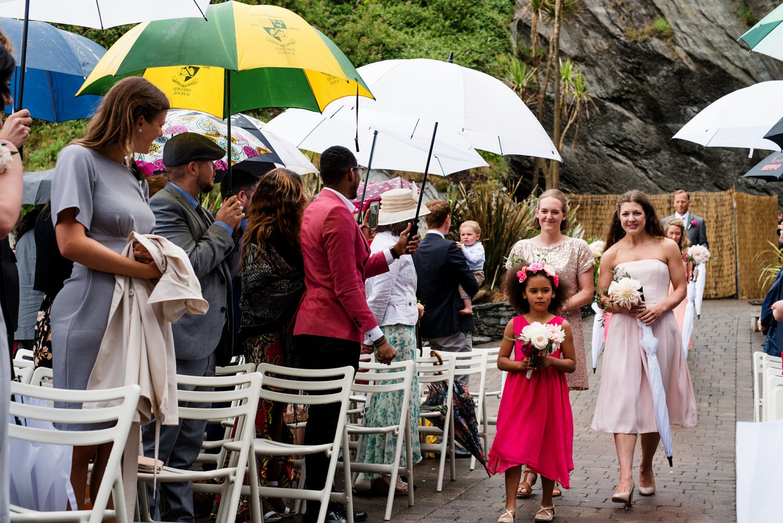 Rainy beach Devon wedding ceremony Babb Photo