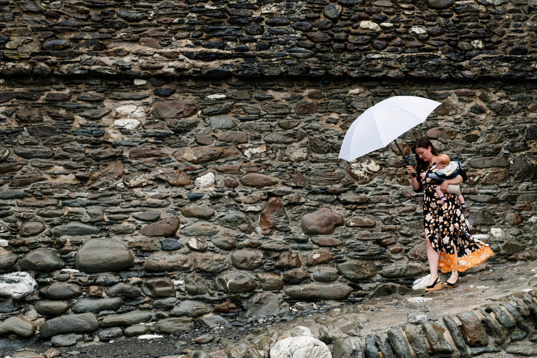 Rainy beach wedding photography Devon