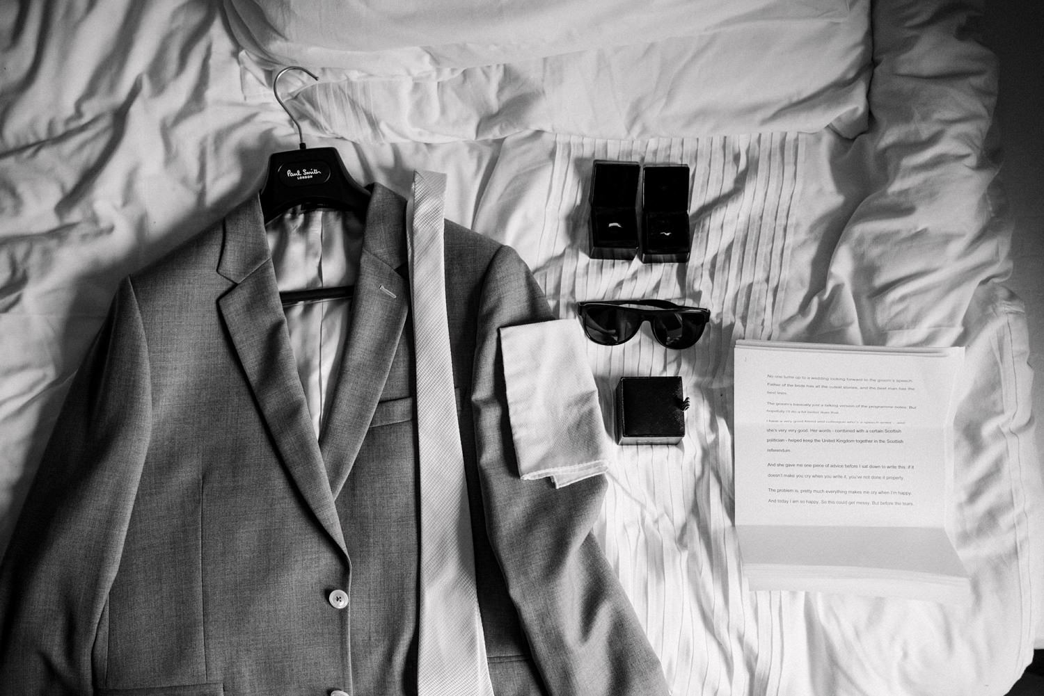 Paul Smith grooms outfit with accessories at Tunnles Beaches Wedding Photographer Devon
