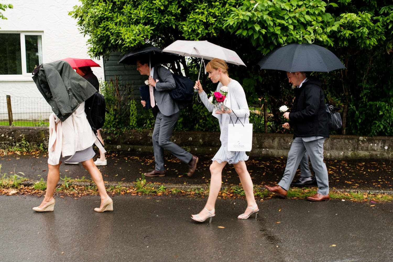 Rainy story telling wedding photography Devon