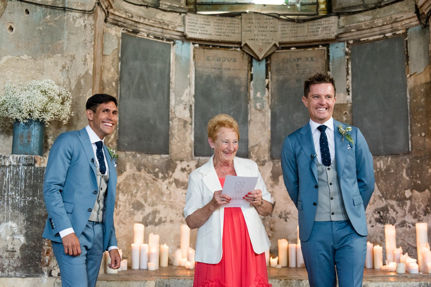 Pastel blue grooms with Mother at same sex warehouse London wedding