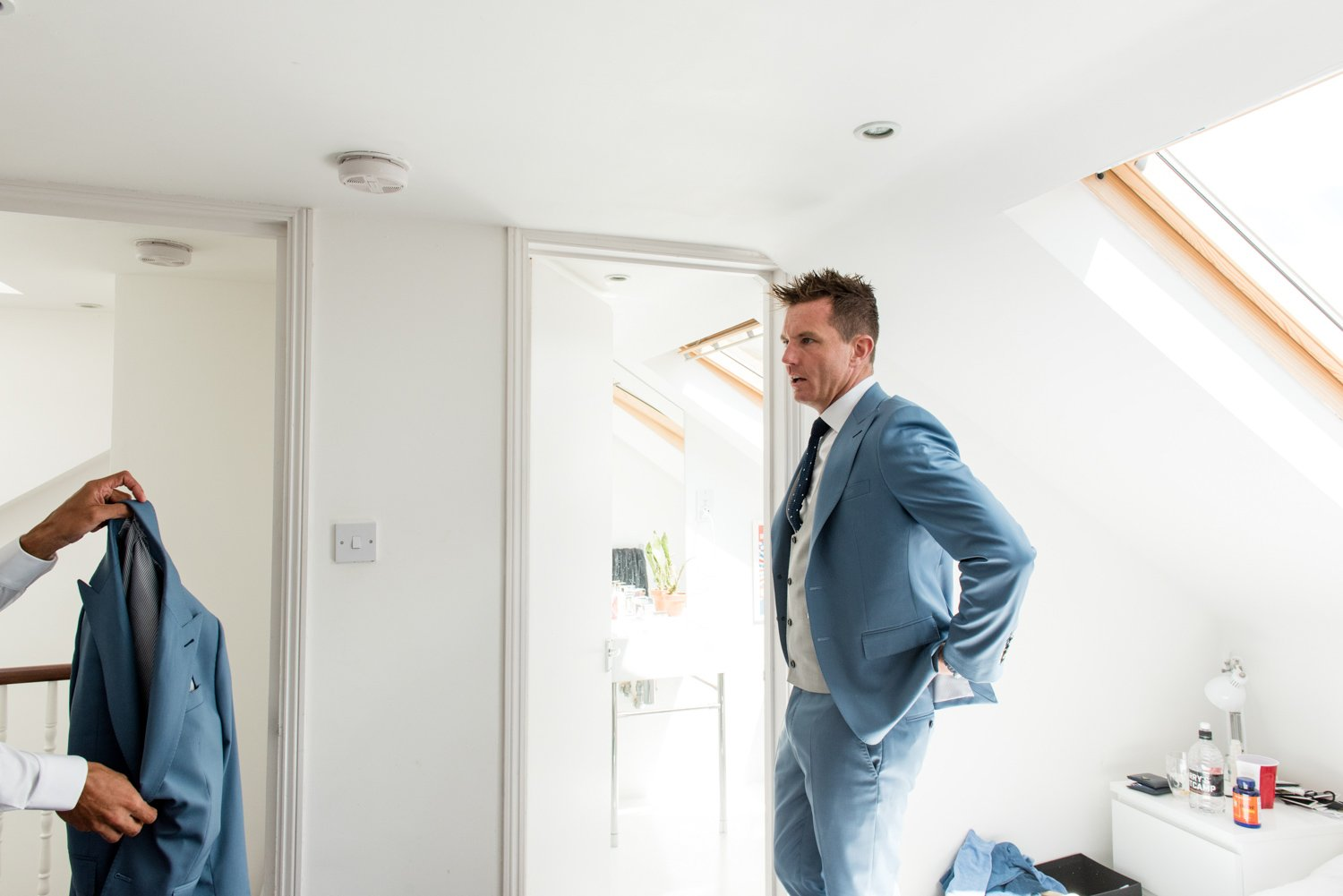 Groom wearing pastel blue suit documentary pre-wedding photography London