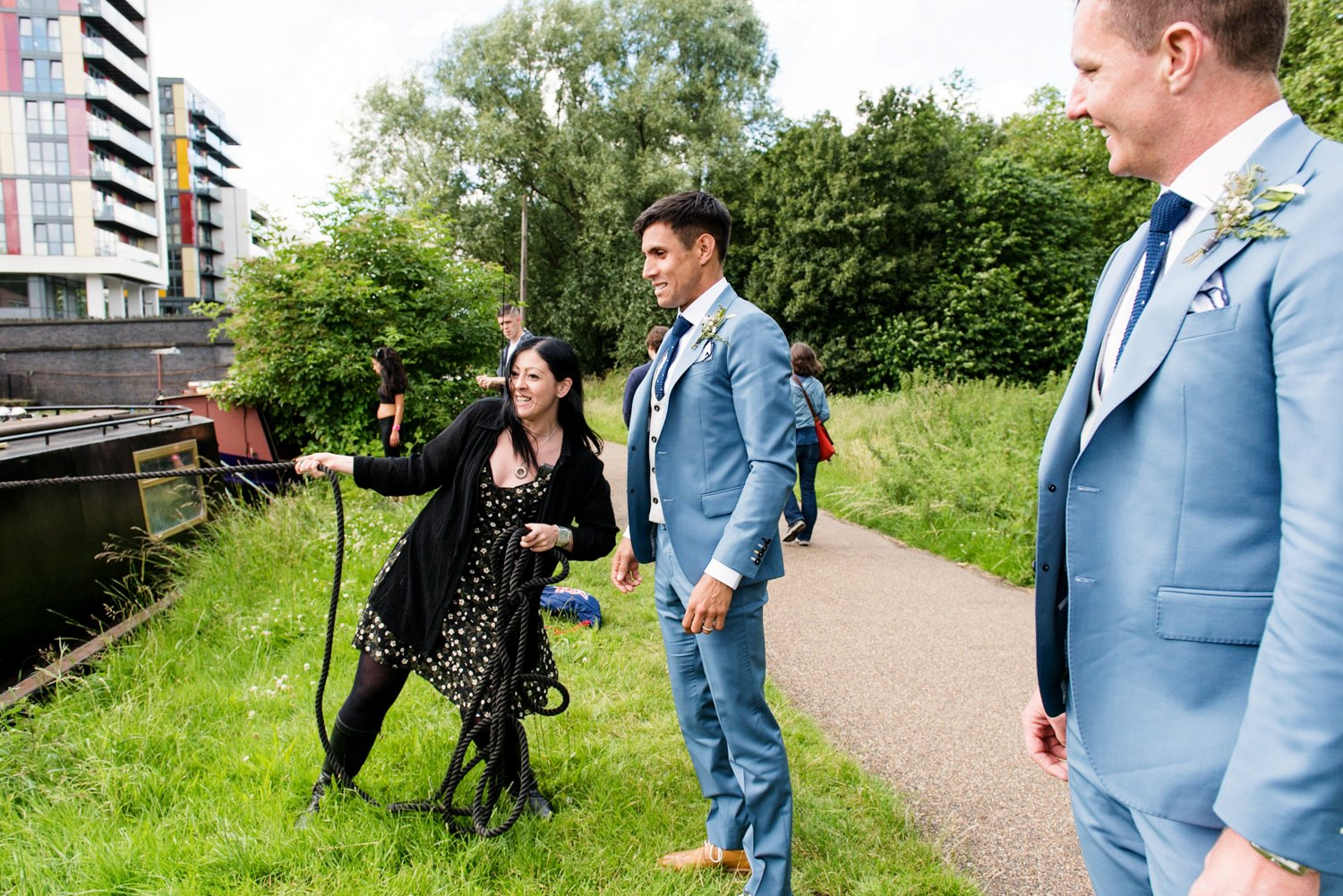 Story telling wedding photography pastel blue grooms watching canal boats London