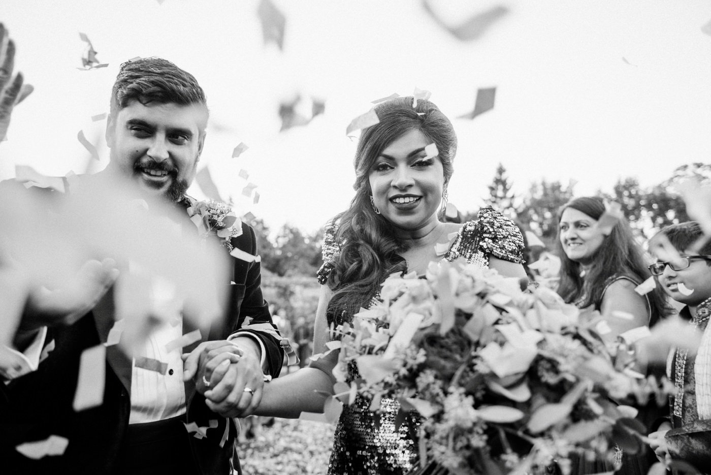 Confetti wedding portrait at Painshill Park Conservatory Surrey