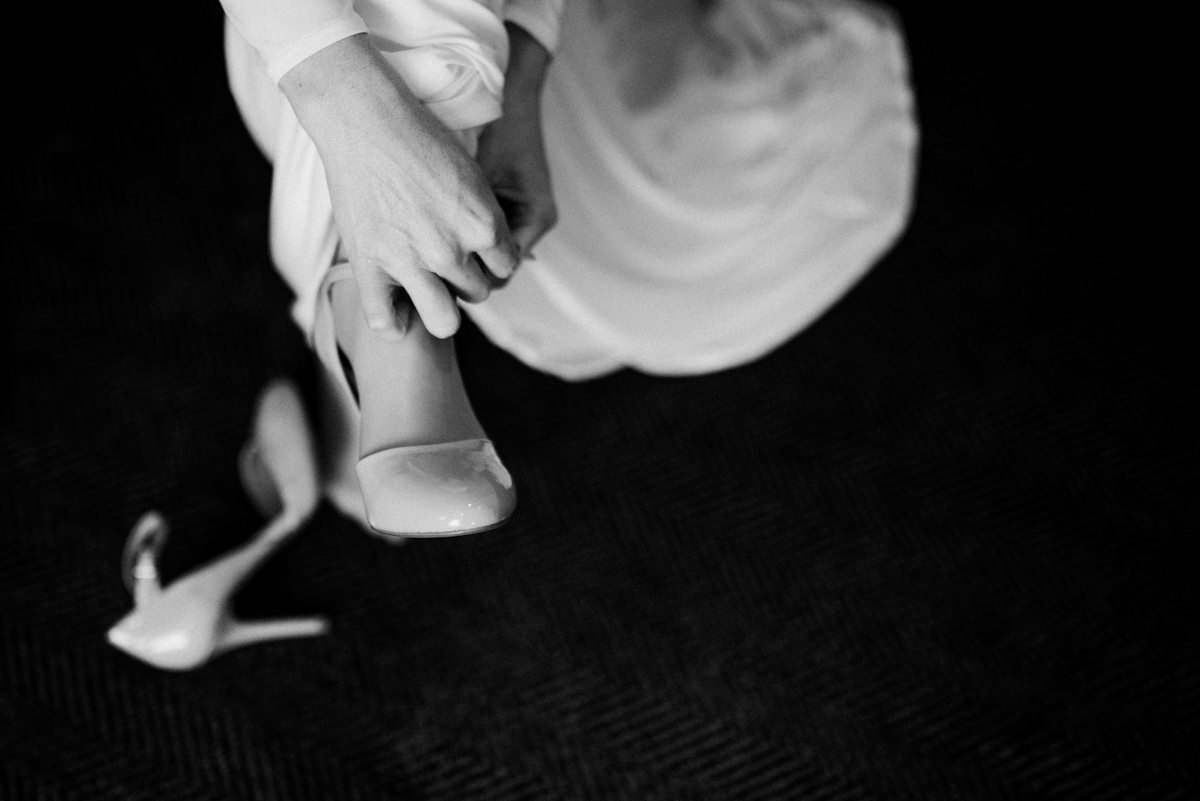 Alternative wedding photographer getting ready black and white