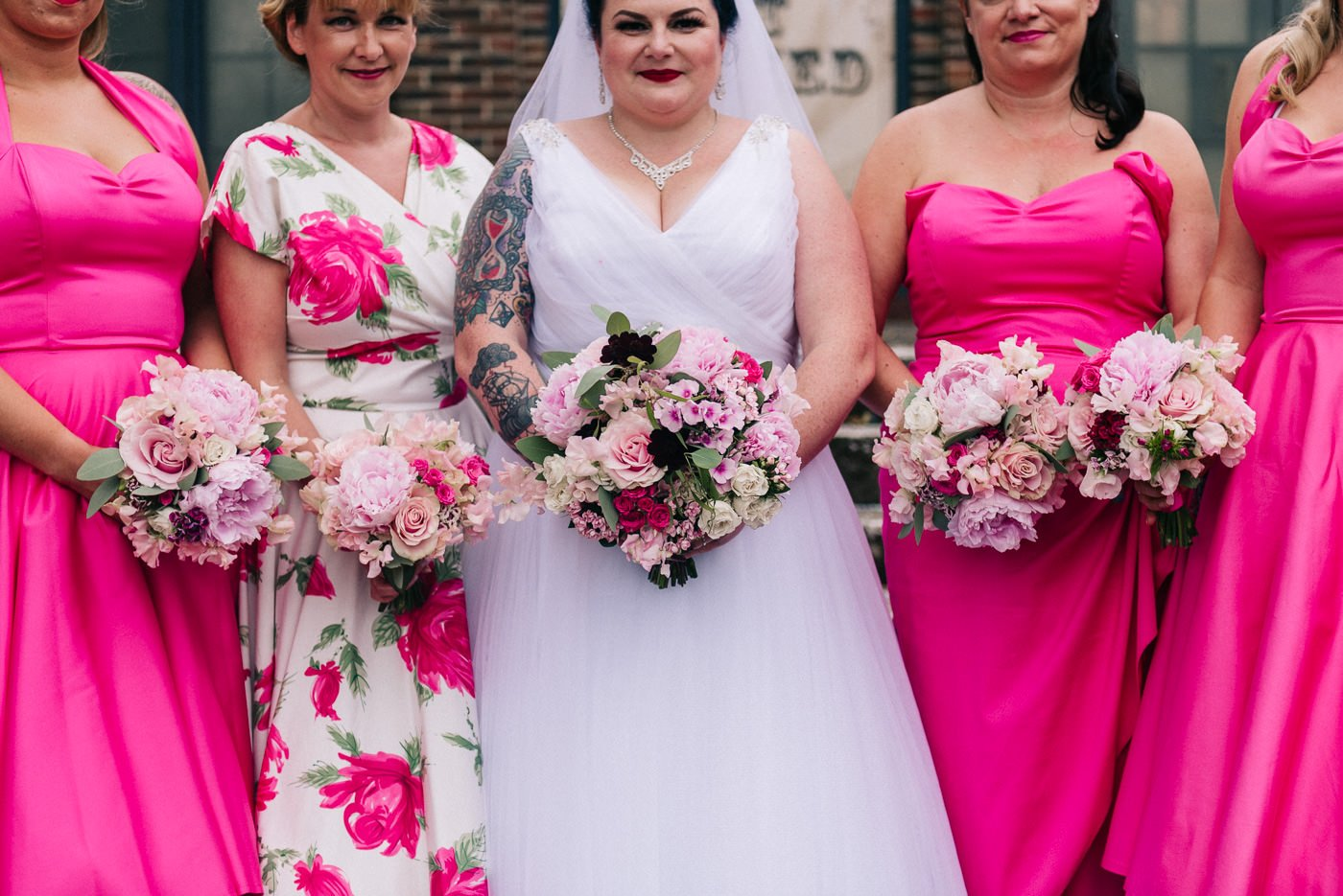 Alternative wedding photographer tattooed bride