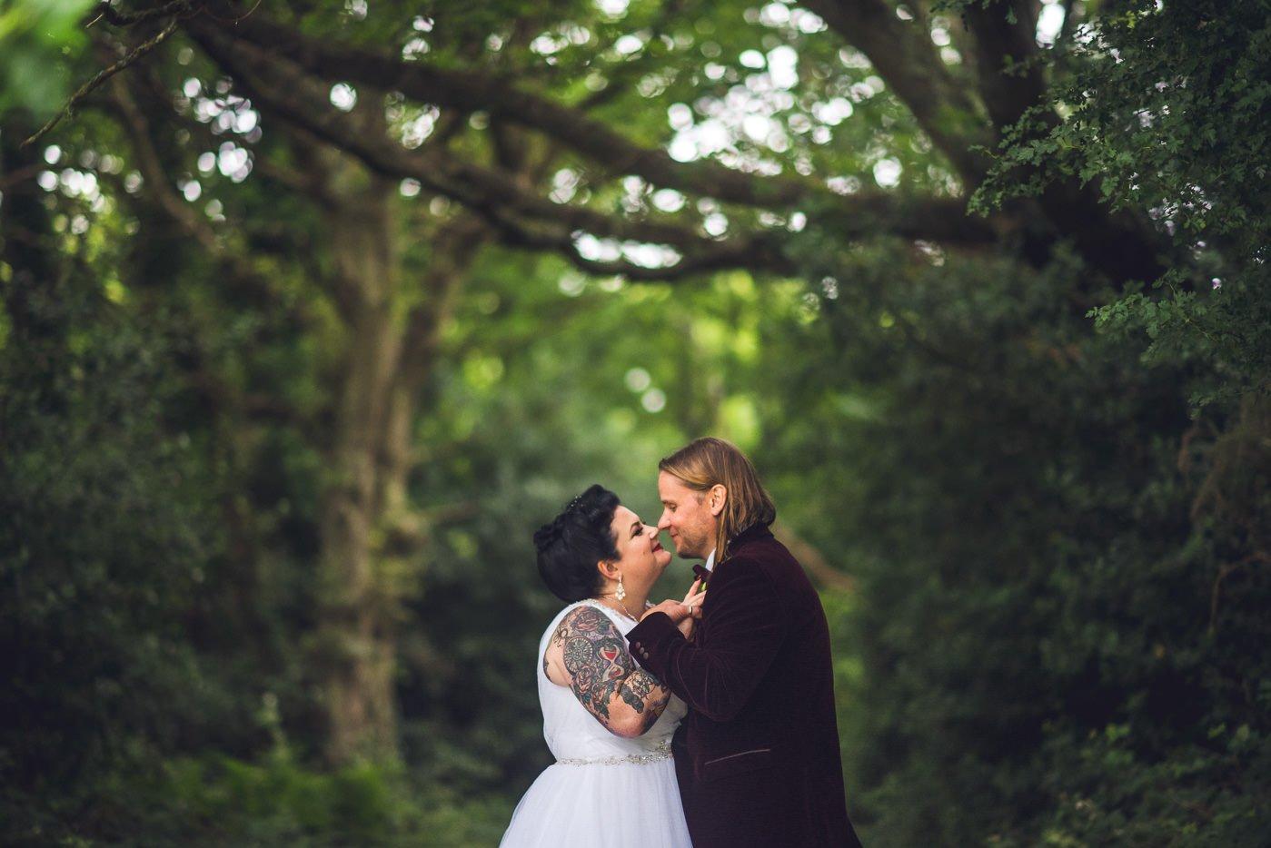 Alternative rock venue wedding tattooed bride
