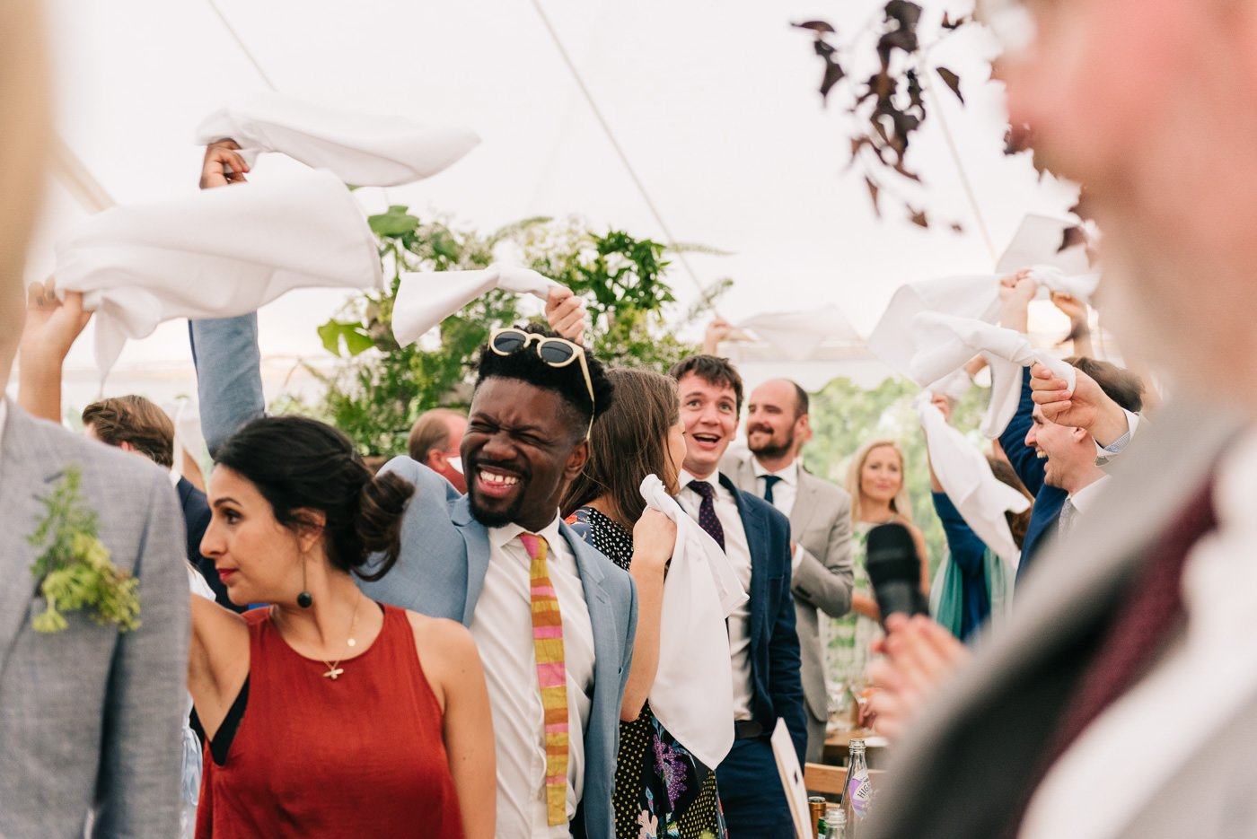 guests wave in bride and groom tetbury wedding