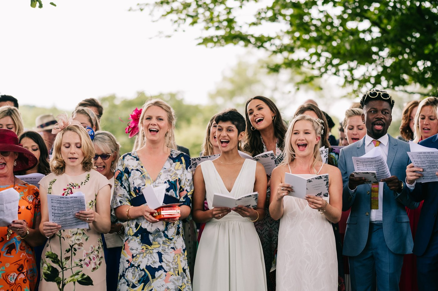 friends and family singing cotswolds outdoor wedding