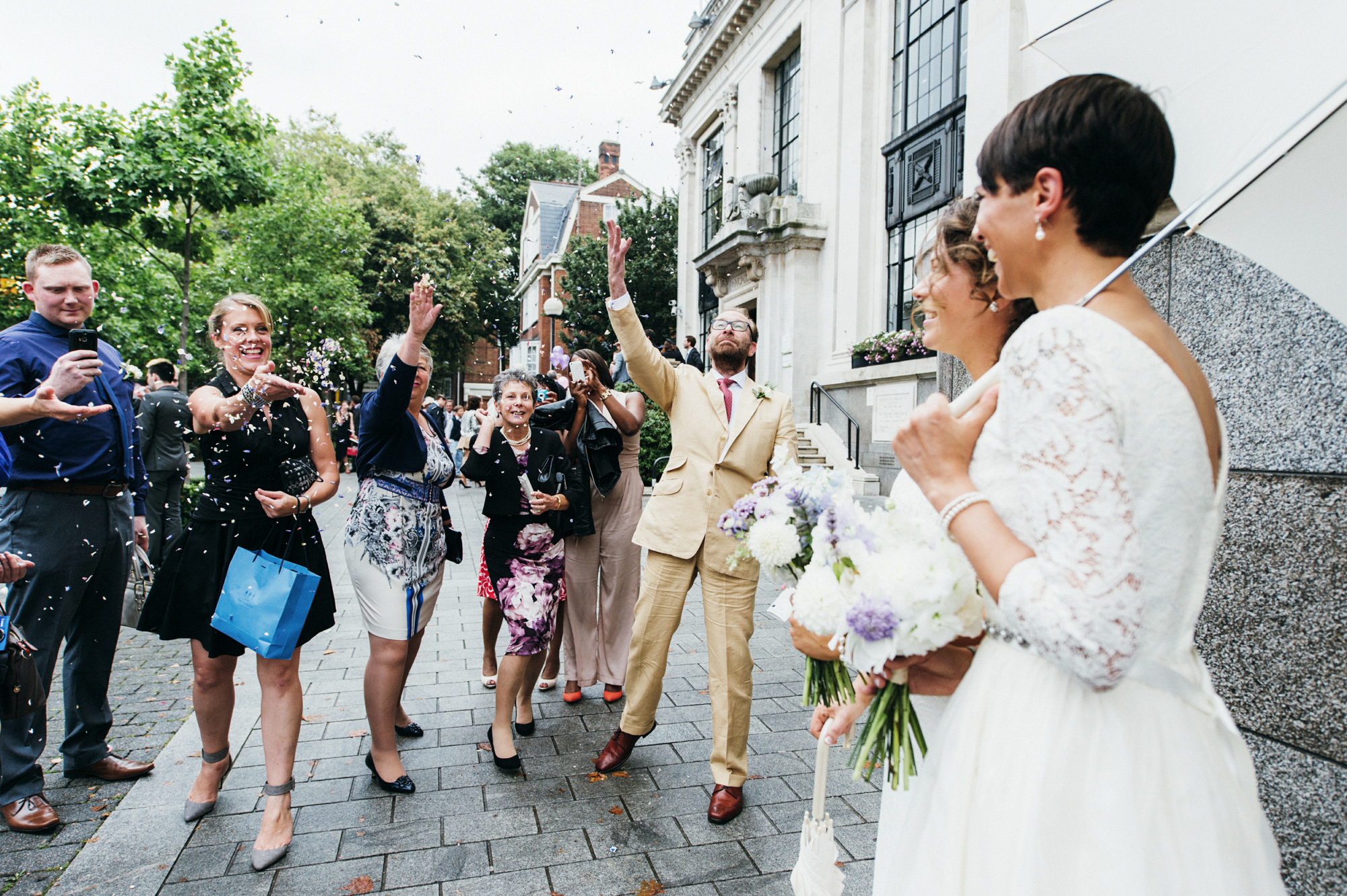 Confetti over gay wedding The Roost Dalston wedding - quirky London wedding photographer © Babb Photo