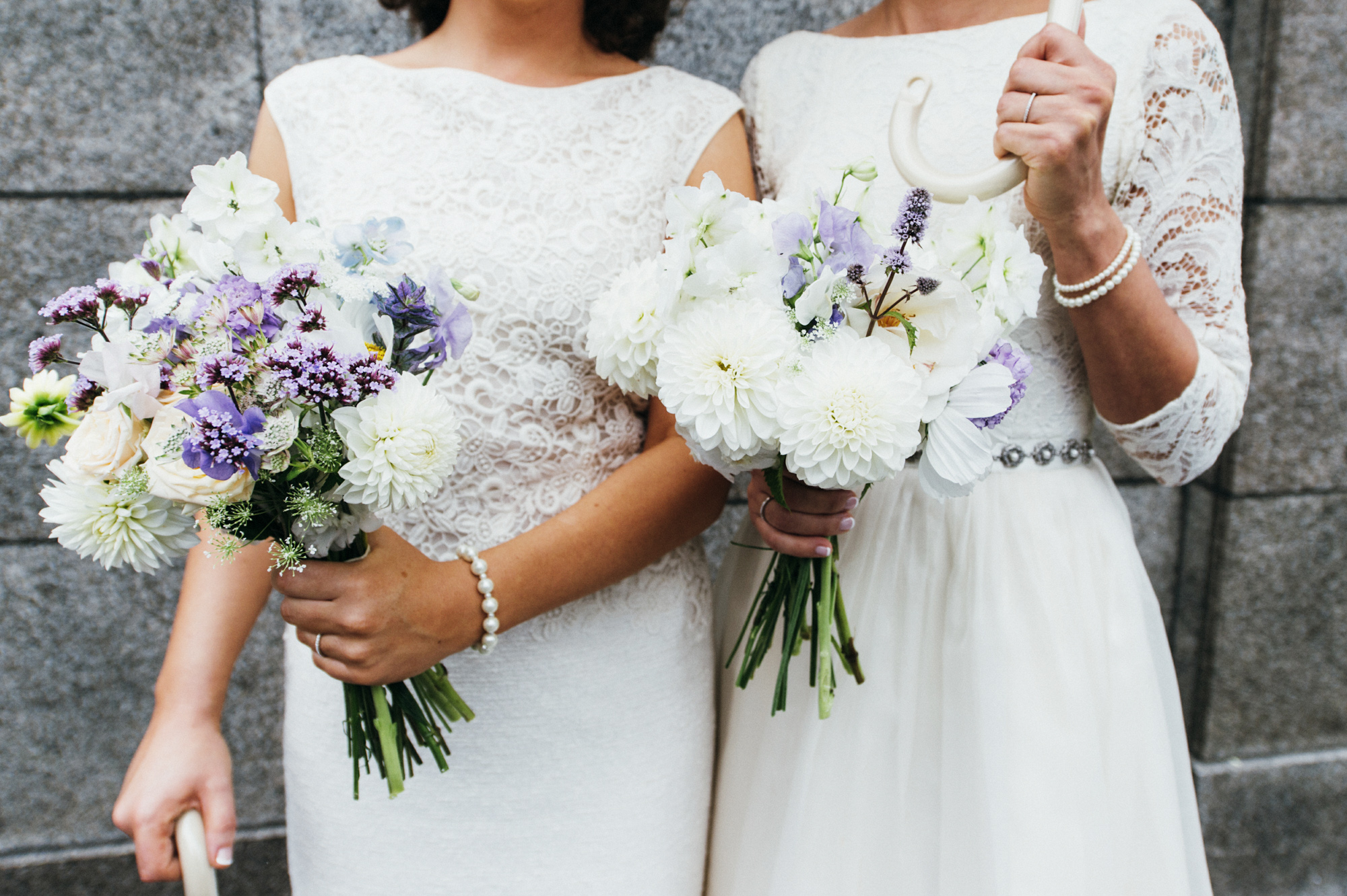 Close up of brides with flowers by The Flower Appreciation Society - gay wedding The Roost Dalston wedding - quirky London wedding photographer © Babb Photo