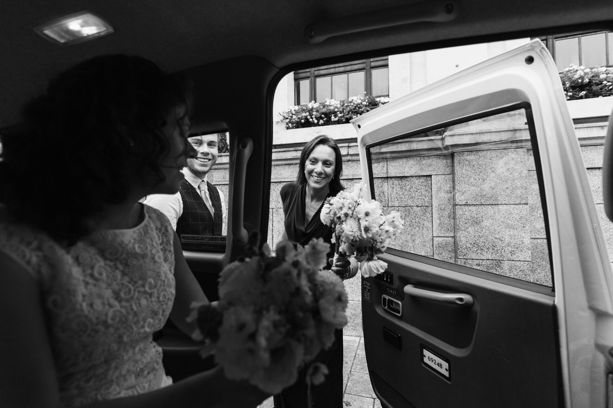 White Union Jack London taxi transport to wedding - gay wedding The Roost Dalston wedding - quirky London wedding photographer © Babb Photo