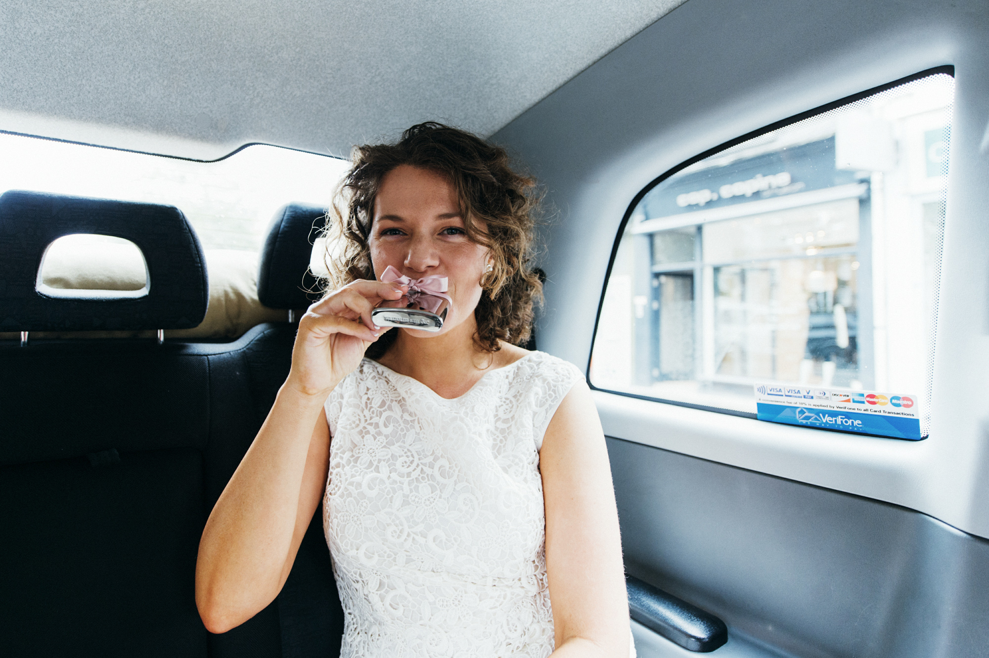 Bride drinking hip flask - gay wedding The Roost Dalston wedding - quirky London wedding photographer © Babb Photo