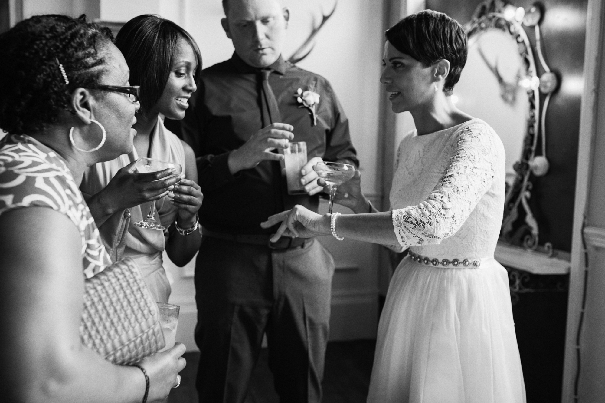Bride chatting to wedding guests - gay wedding The Roost Dalston wedding - quirky casual London wedding photographer © Babb Photo