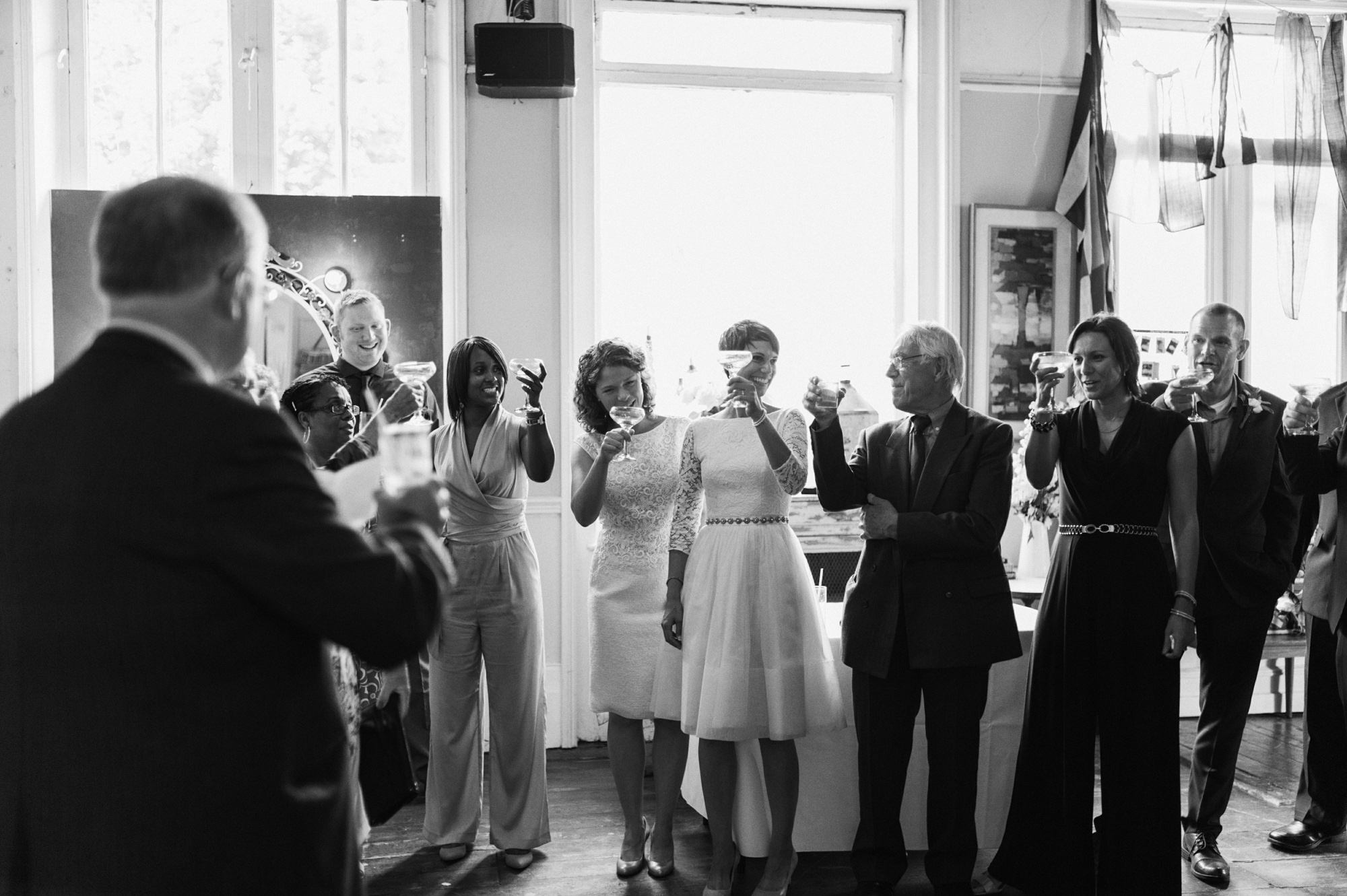 Toasting the gay wedding The Roost Dalston wedding - quirky London wedding photographer © Babb Photo