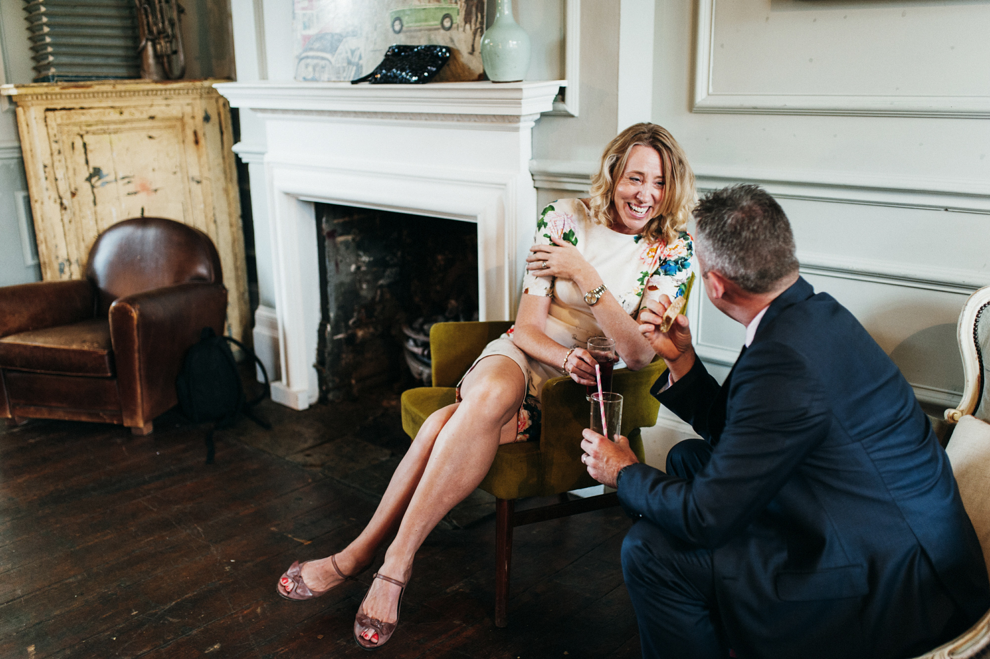 Laughing wedding guests at gay wedding The Roost Dalston wedding - quirky London wedding photographer © Babb Photo