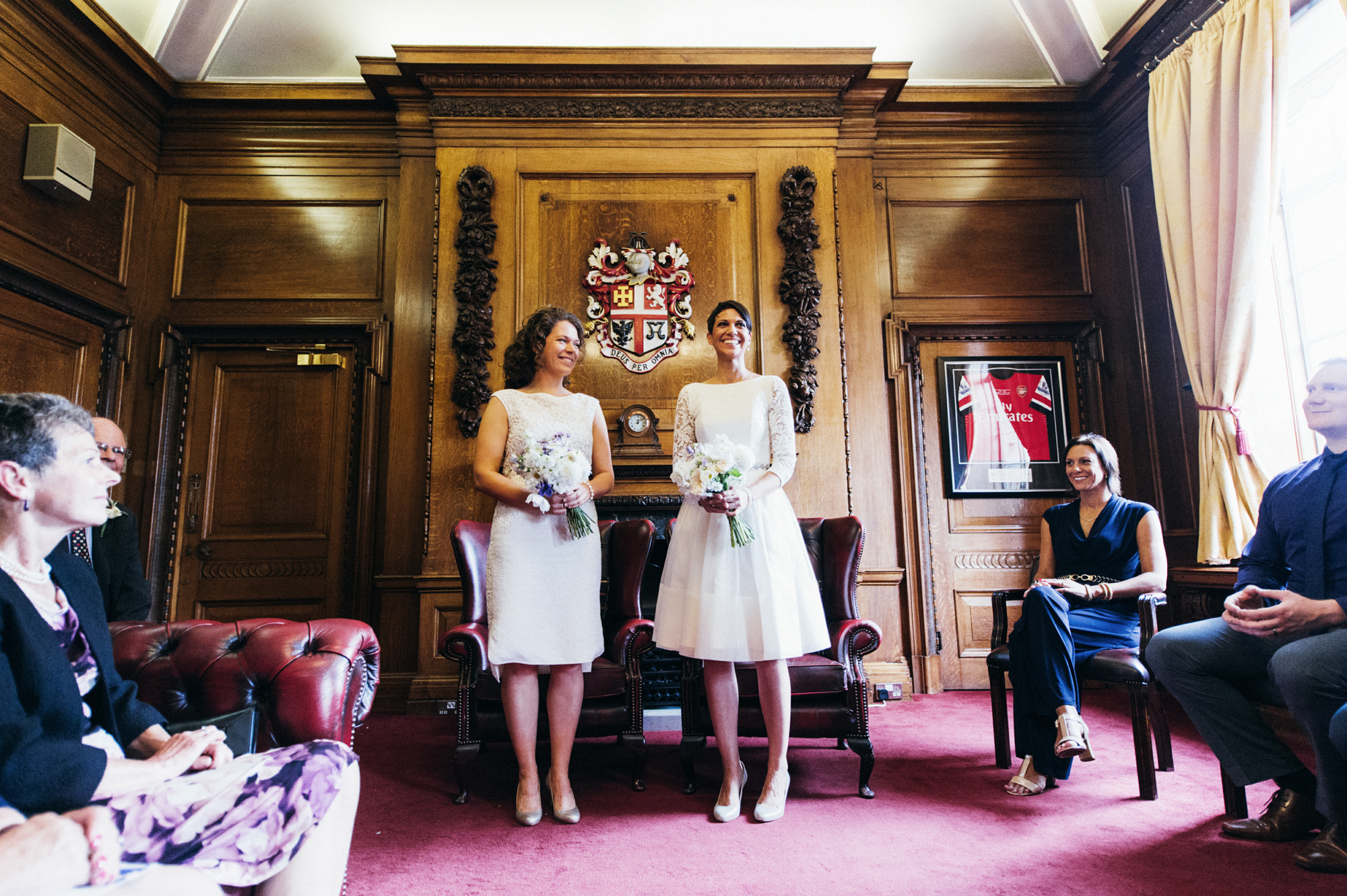 Two brides in short wedding dresses at The Mayors Parlour - gay wedding The Roost Dalston wedding - quirky London wedding photographer © Babb Photo