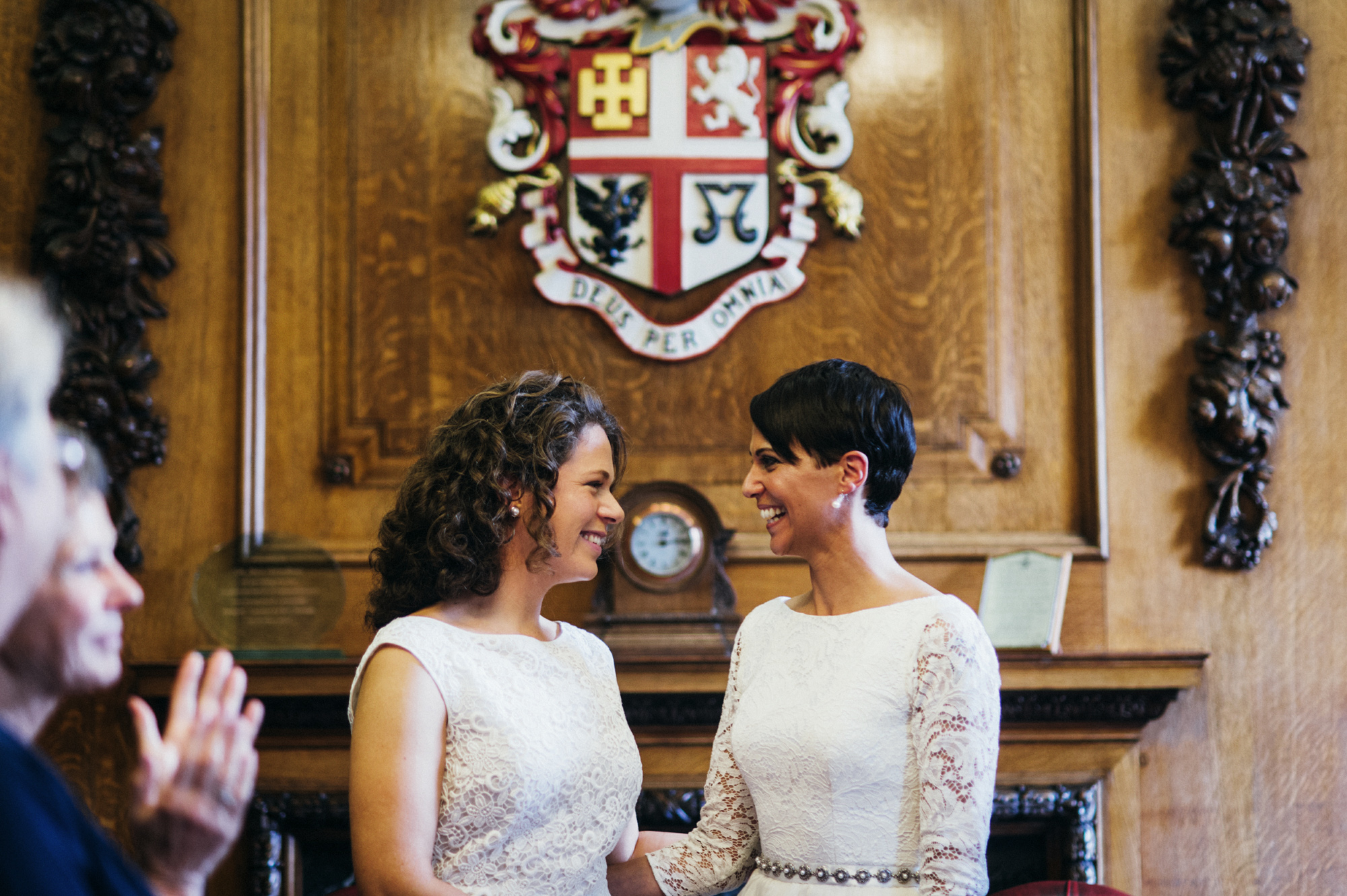 Gay wedding smiling brides at the Mayors parlour - gay wedding The Roost Dalston wedding - quirky London wedding photographer © Babb Photo