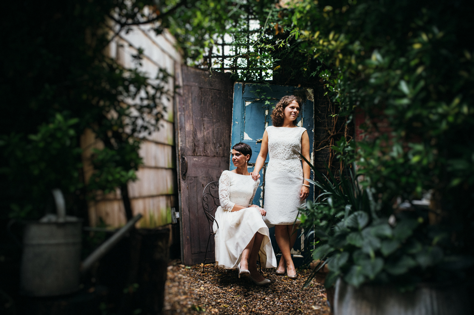Lesbian brides in the garden at the Roost pub Dalston - same sex wedding photography The Roost Dalston London wedding photographer © Babb Photo