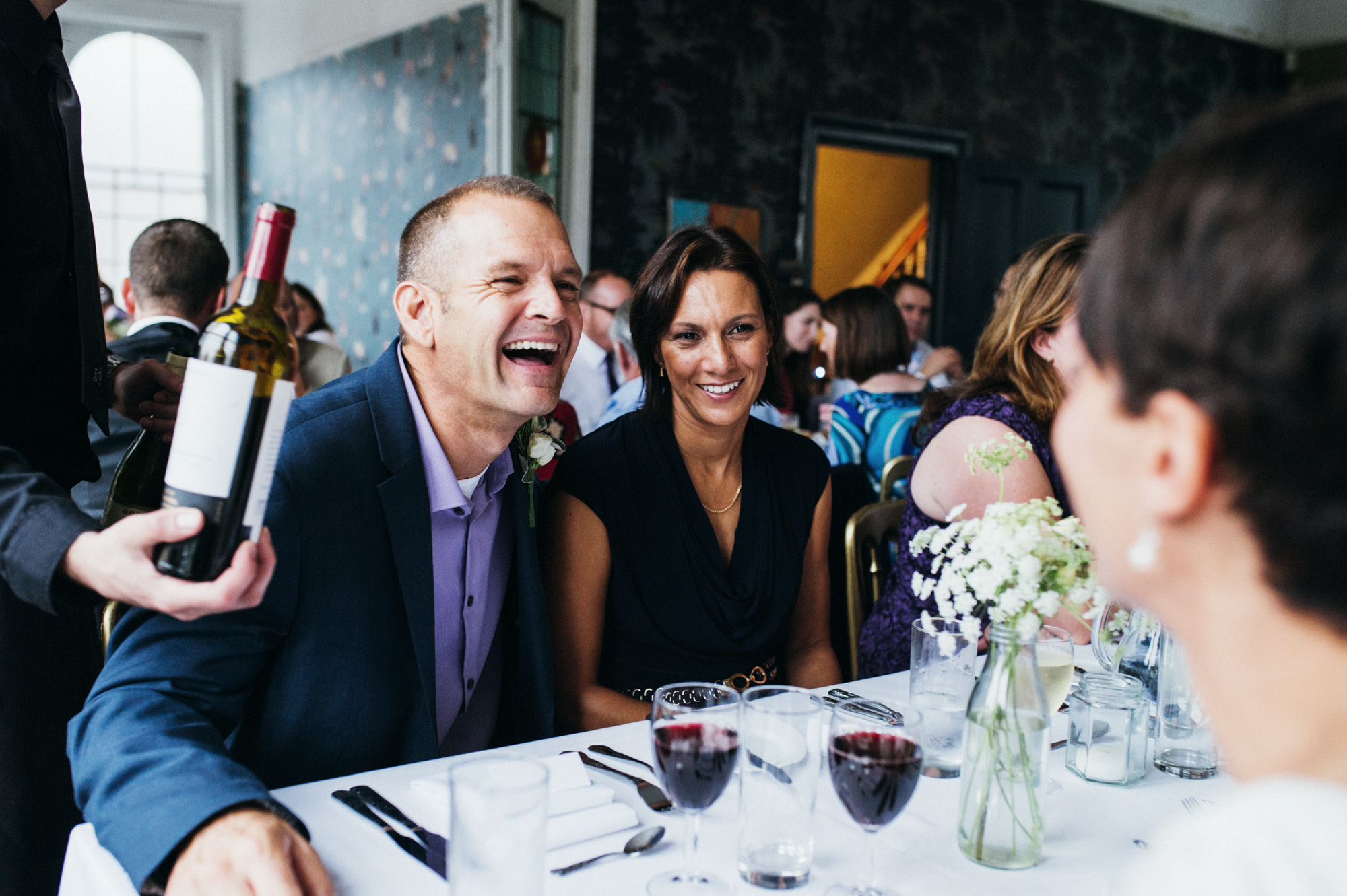 Laughing and wine - quirky creative gay friendly wedding photographer The Roost Dalston London wedding photographer © Babb Photo
