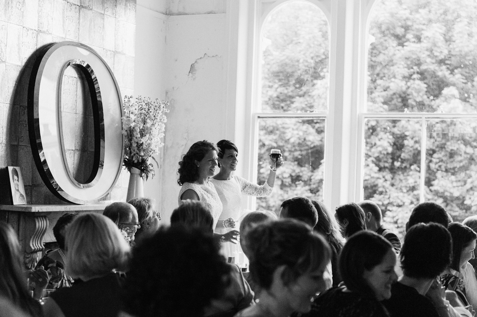 Lesbian brides toasting - quirky creative gay friendly wedding photographer The Roost Dalston London wedding photographer © Babb Photo