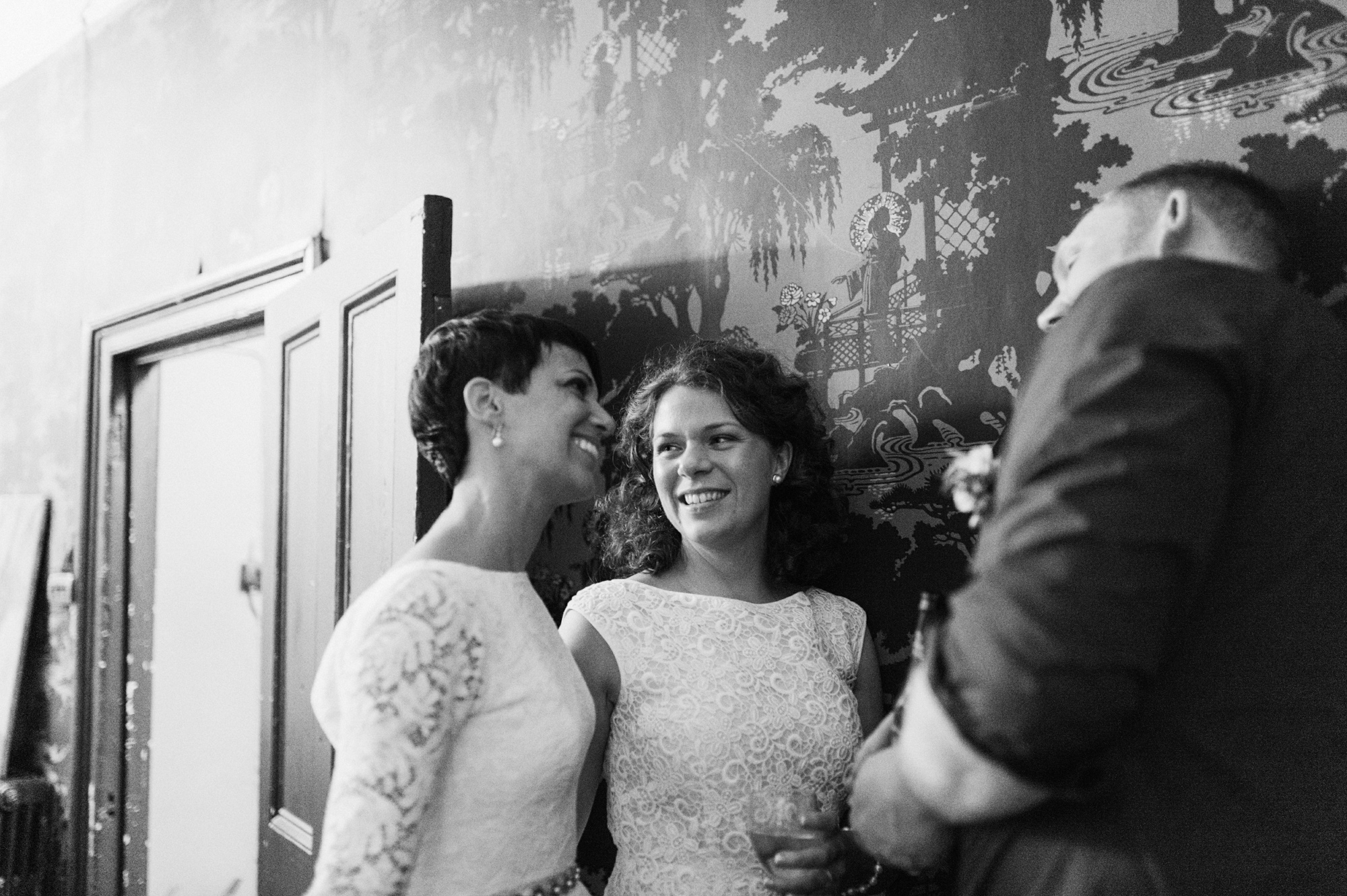Lace wedding dress for lesbian brides - London gay wedding photographer The Roost Dalston London wedding photographer © Babb Photo