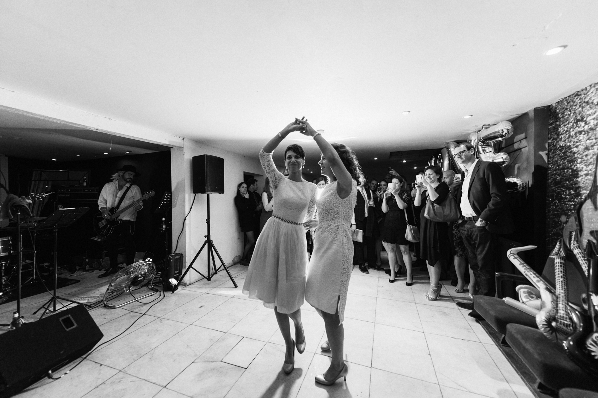 Lesbian brides dancing - quirky creative gay friendly wedding photographer The Roost Dalston London wedding photographer © Babb Photo