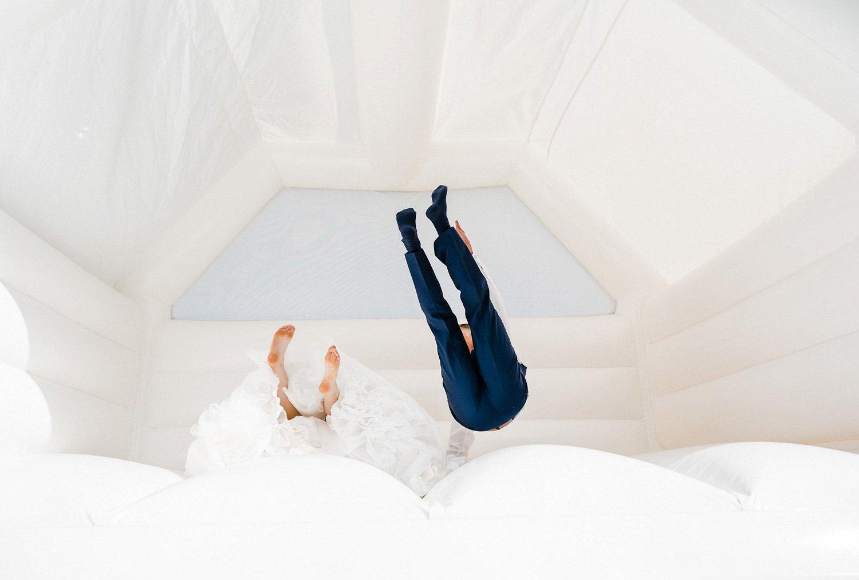 wedding couple on a bouncy castle