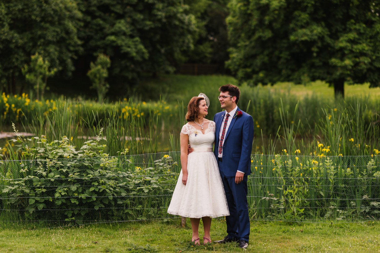 wedding couple in Hampton Court house gardens
