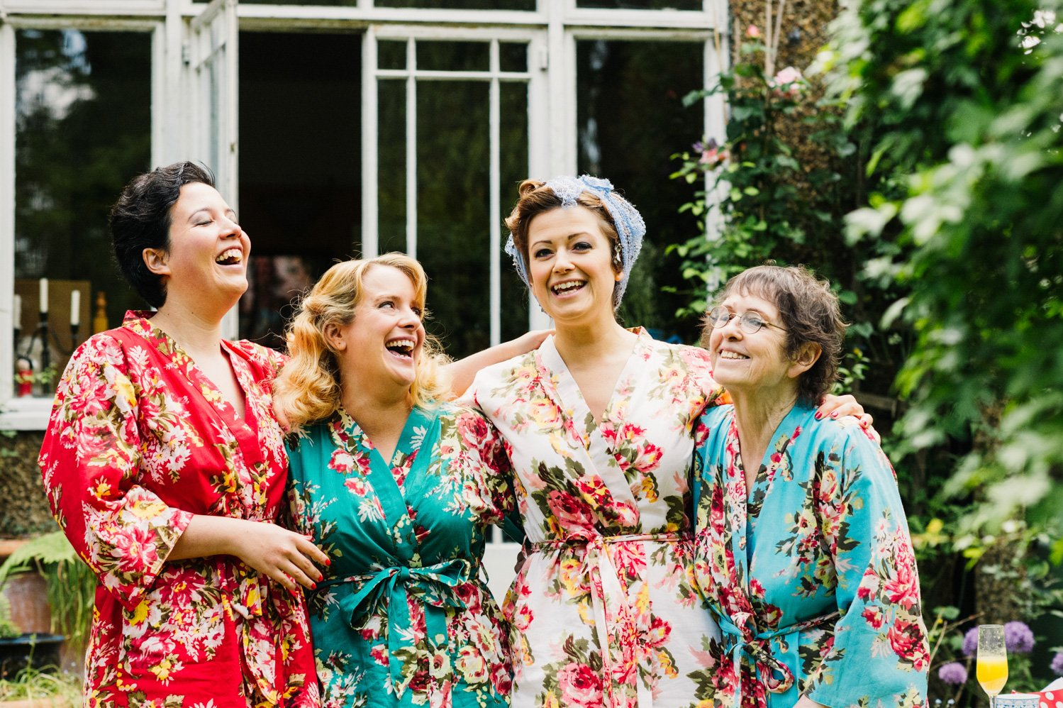 bridesmaids in garden in dressing gowns getting ready wedding photography