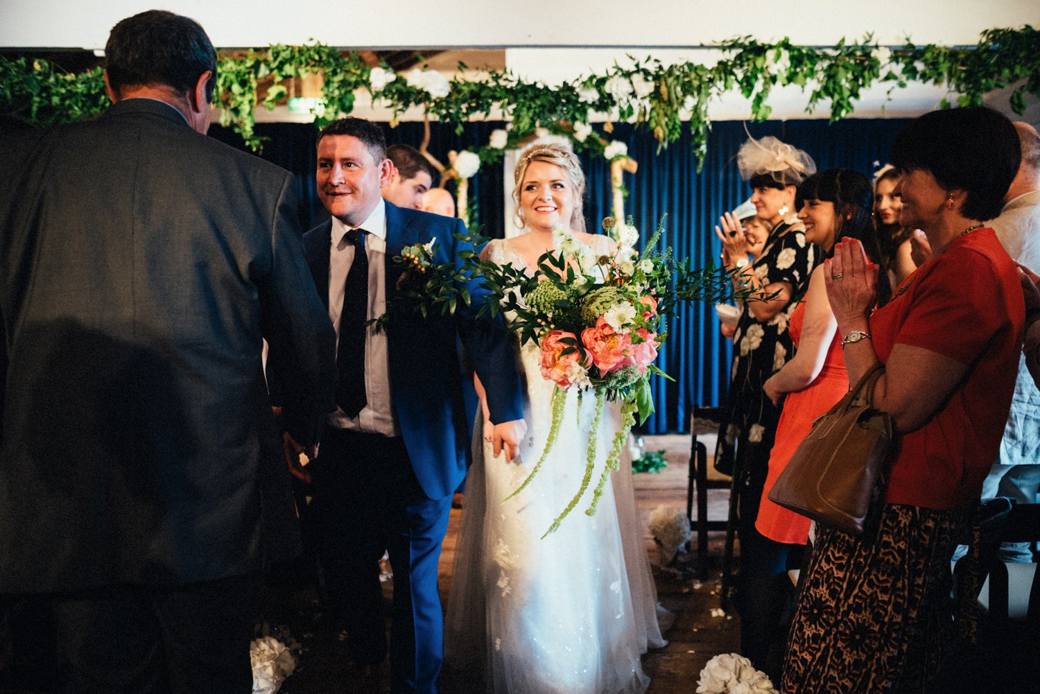 Guests congratulate married couple BABB