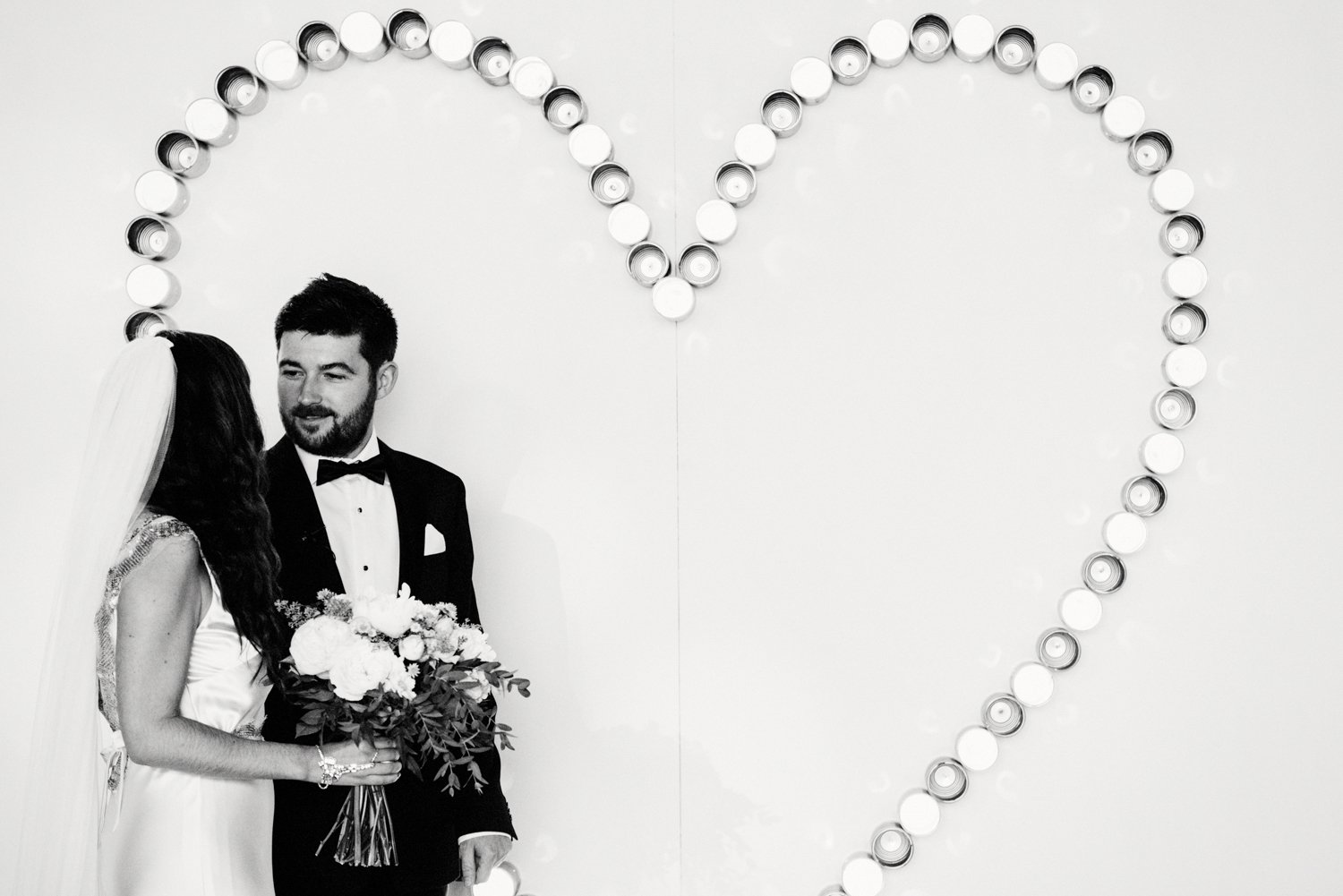 Creative wedding photography - giant heart backdrop