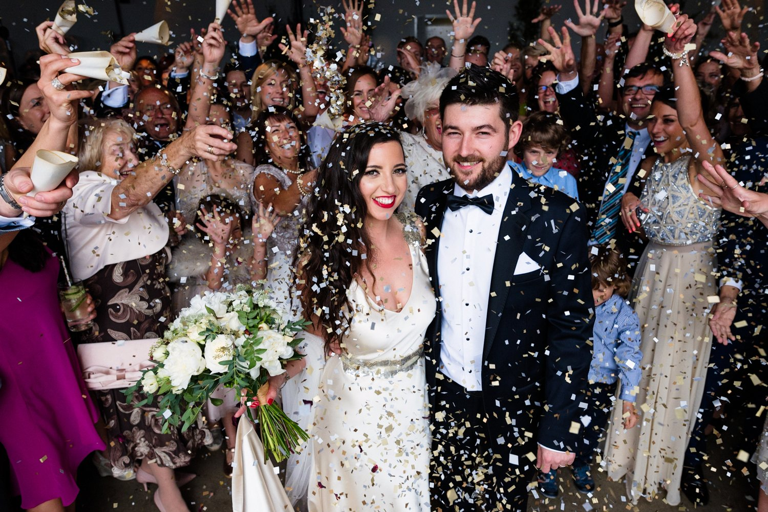 Glam London wedding confetti shot The Chainstore Wedding Photography