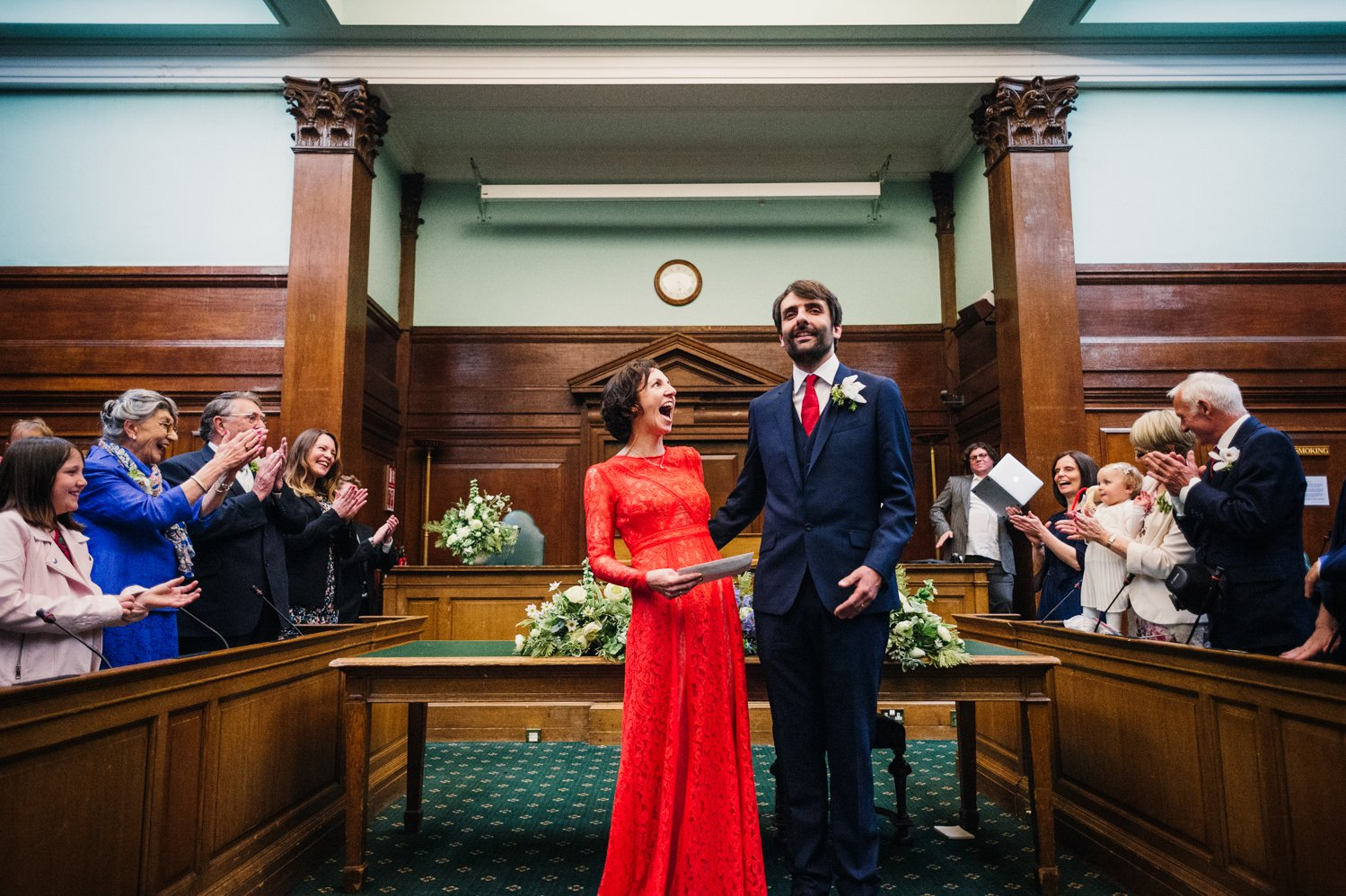 A bride in a red dress at Camden Town Hall