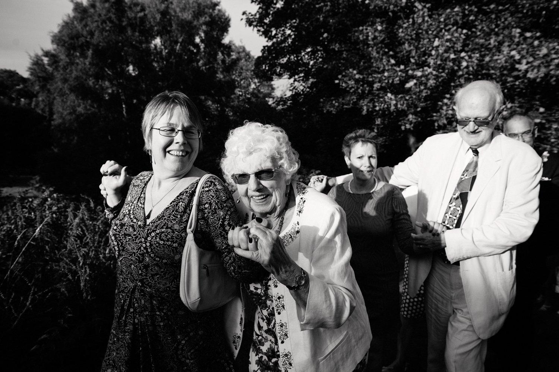 Wedding guests enjoy outdoor Ceilidh