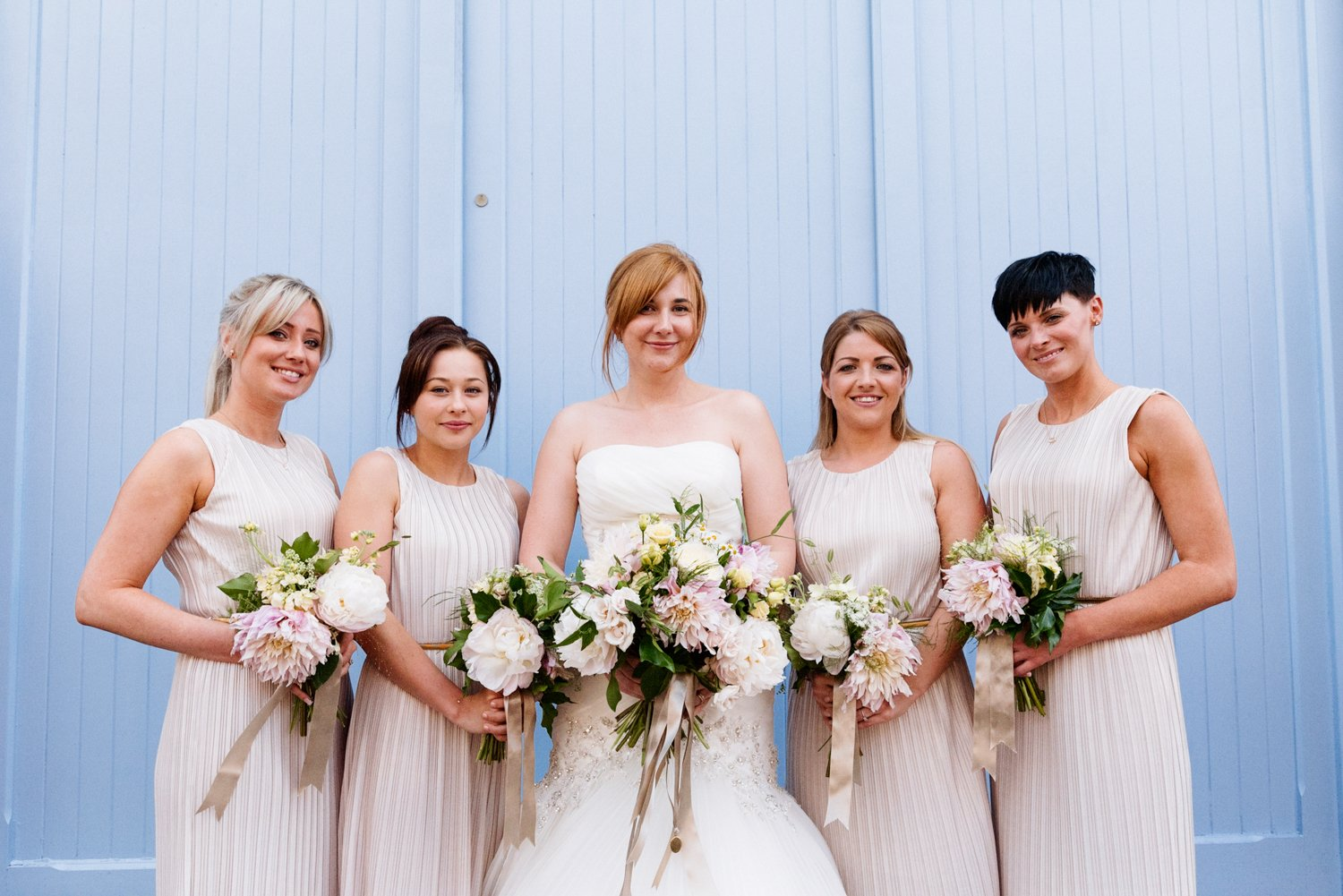 pastel flowers and bridesmaids outside fazeley studios Birmingham