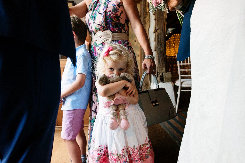 Girl hugging bear Old Luxters Barn Wedding Photography