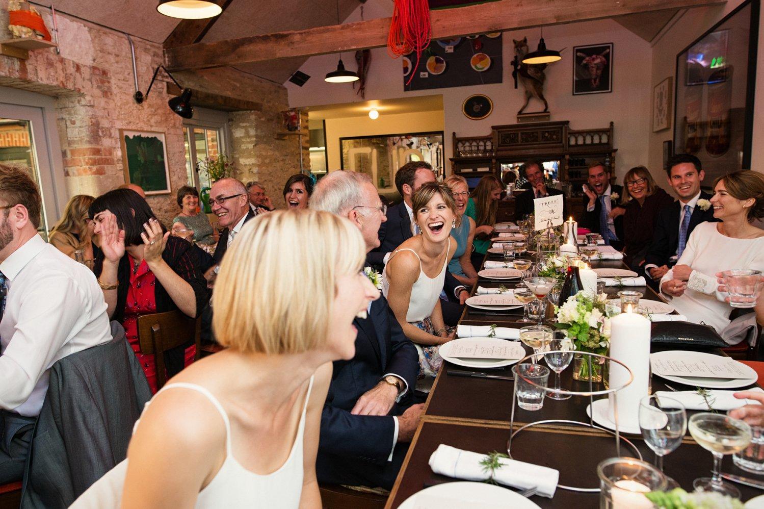 Laughing during wedding speeches Somerset wedding Babb