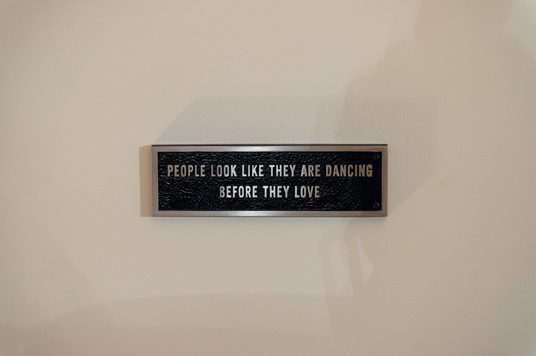 People look like they are dancing sign