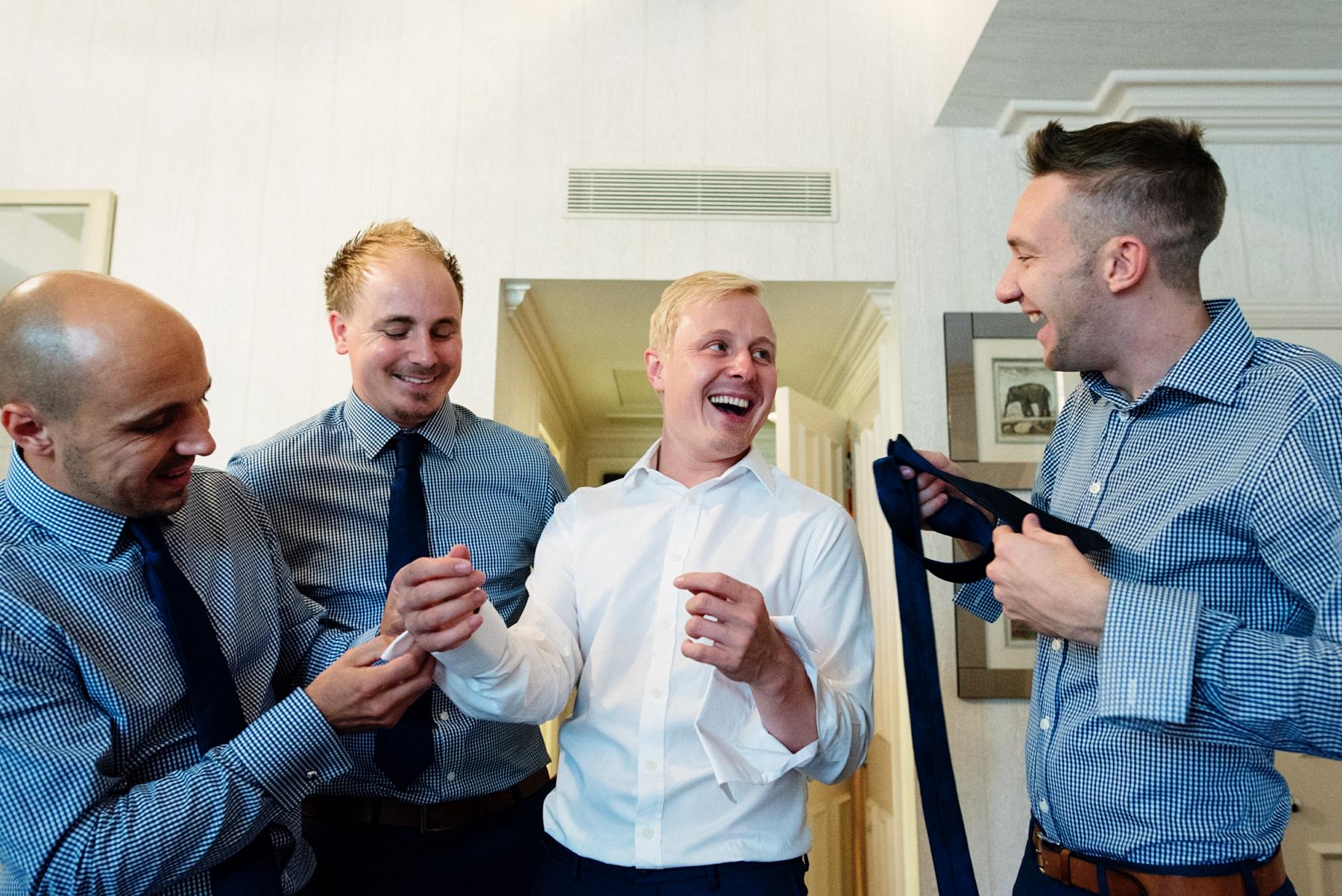 Hawes & Curtis groom with groomsmen Babb