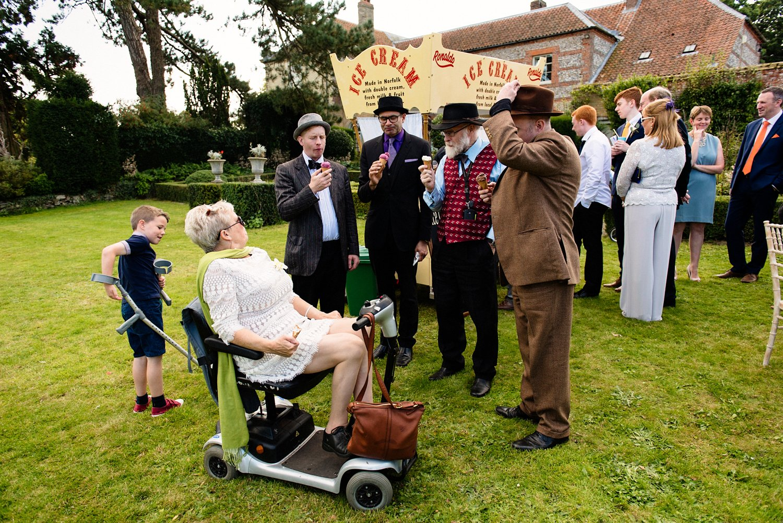 Wedding guests enjoying ice-cream West Lexham, Norfolk