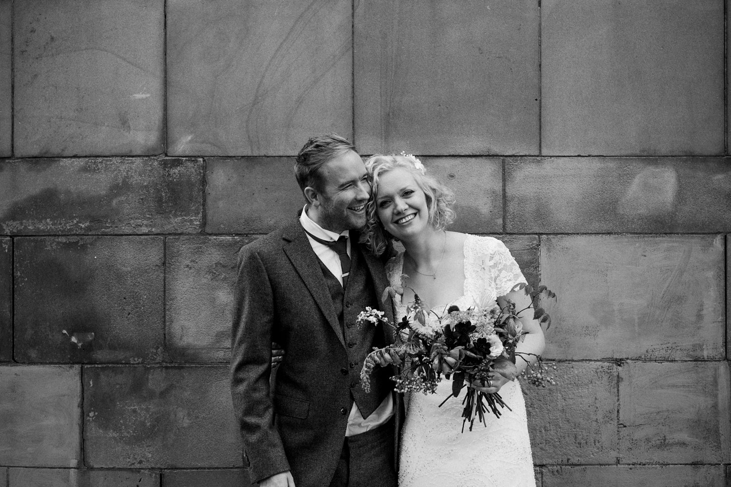 Phase Eight bride with Jigsaw groom wedding portrait Scotland