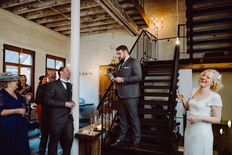 Phase Eight bride giggling listening to best man speech Scotland