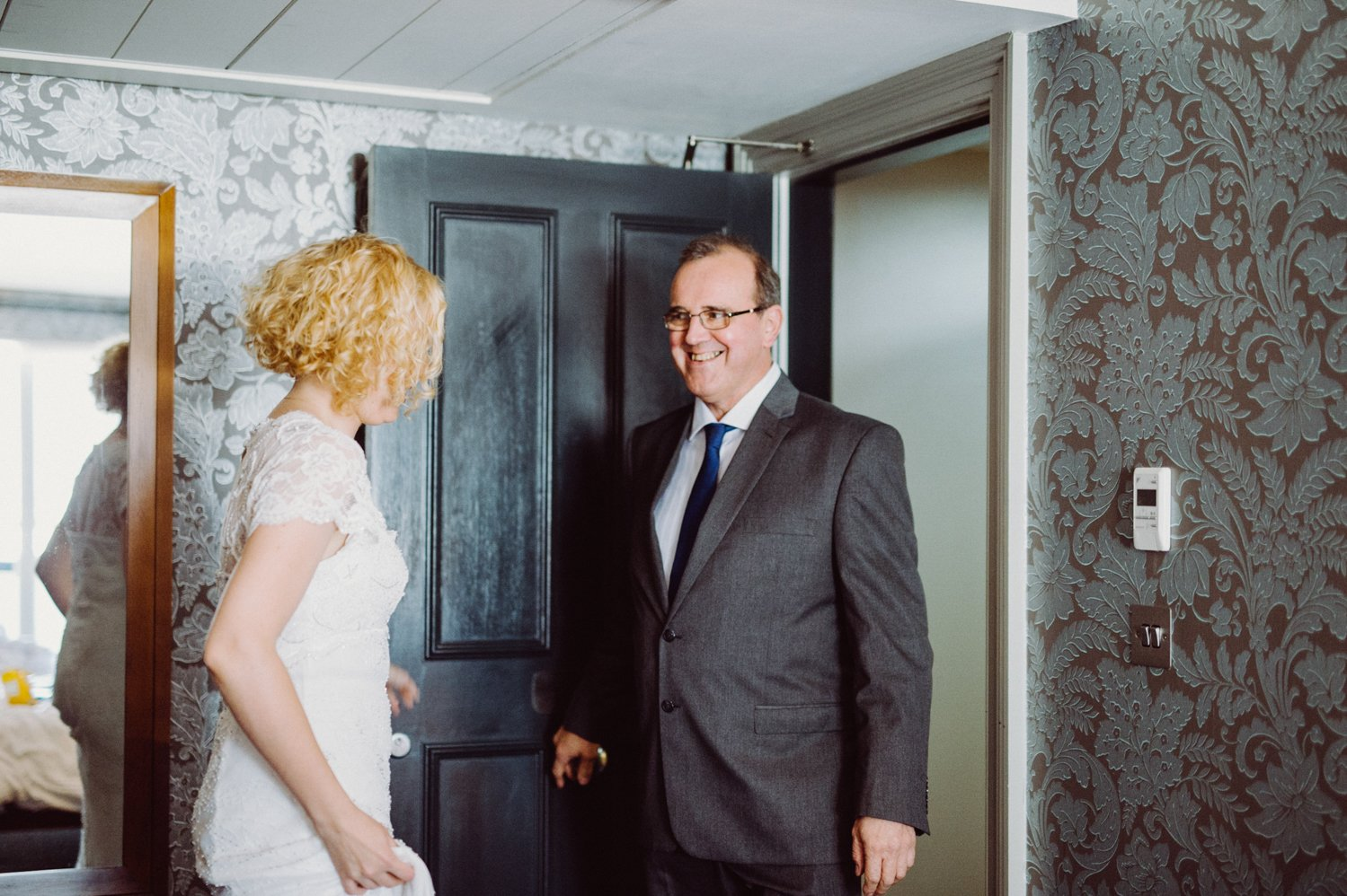 Phase Eight bride greets Father pre-wedding Scotland