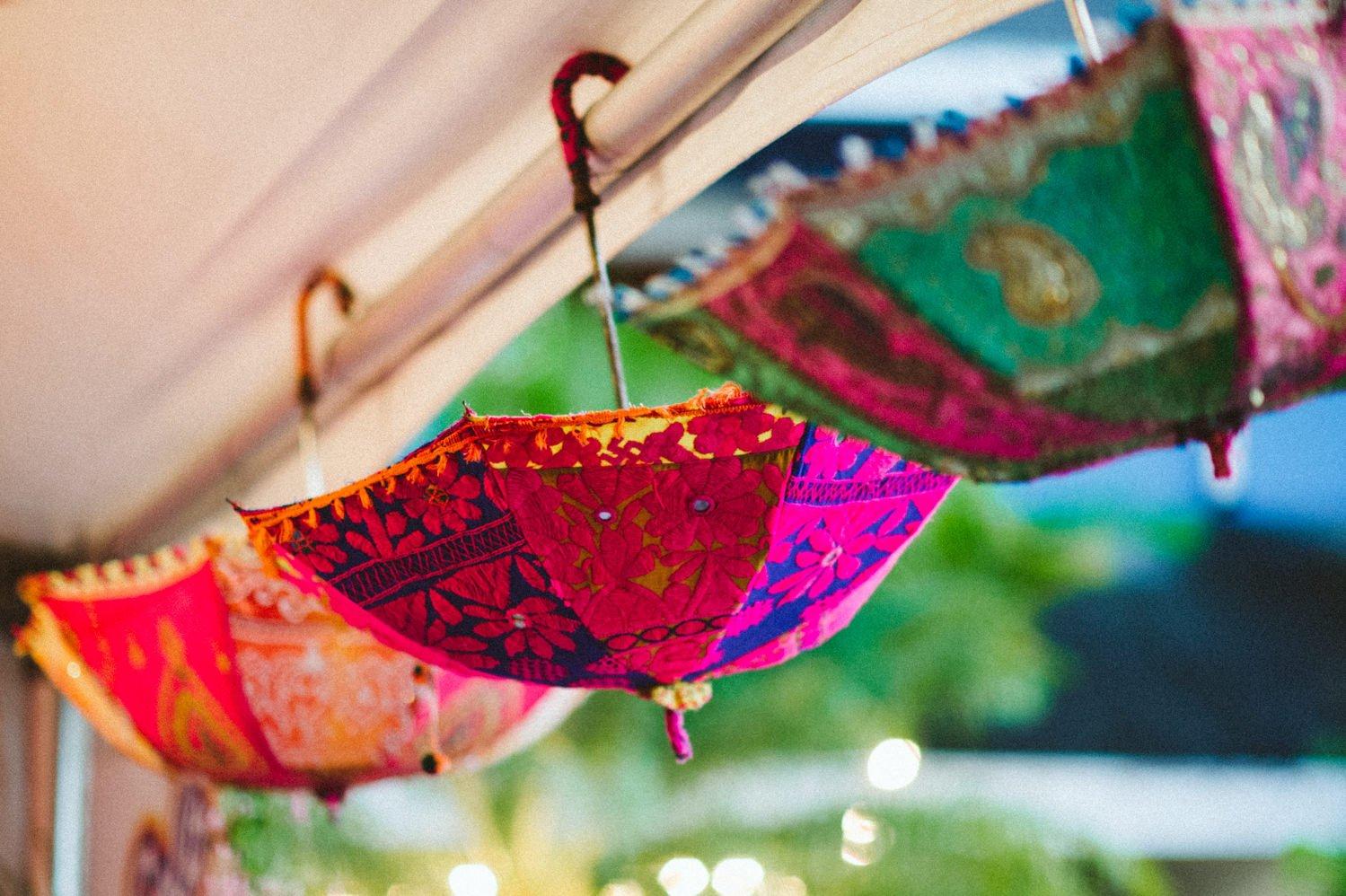 Bright umbrellas decorate Tobago wedding
